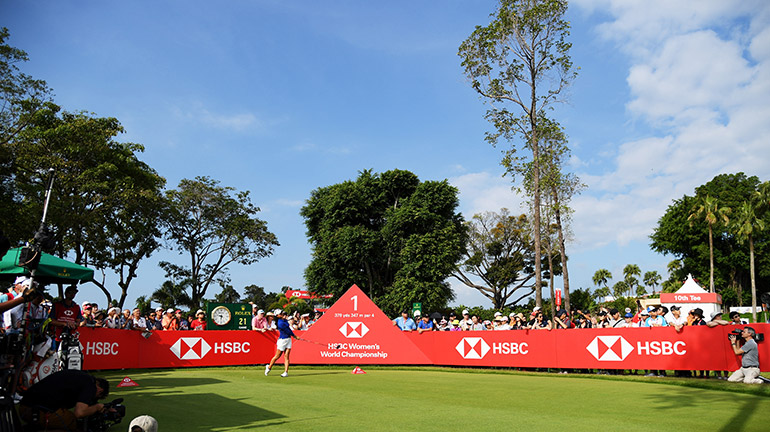 Women playing golf at an HSBC event